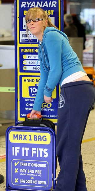 Ryanair bag size check at Dublin Airport</p> <p>Pic Chris Bacon