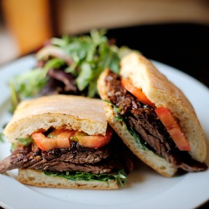 grilled_steak_sandwich_with_caramelized_onions_tomatoes_and_lettuce_on_ciabatta_14.50